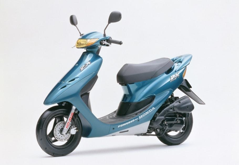 センタースタンド・ロック機構を装備したスポーティなメットインスクーター「ホンダ Dio ZX」のカラーリングと細部を変更し発売
